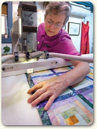 Brenda at the quilting machine